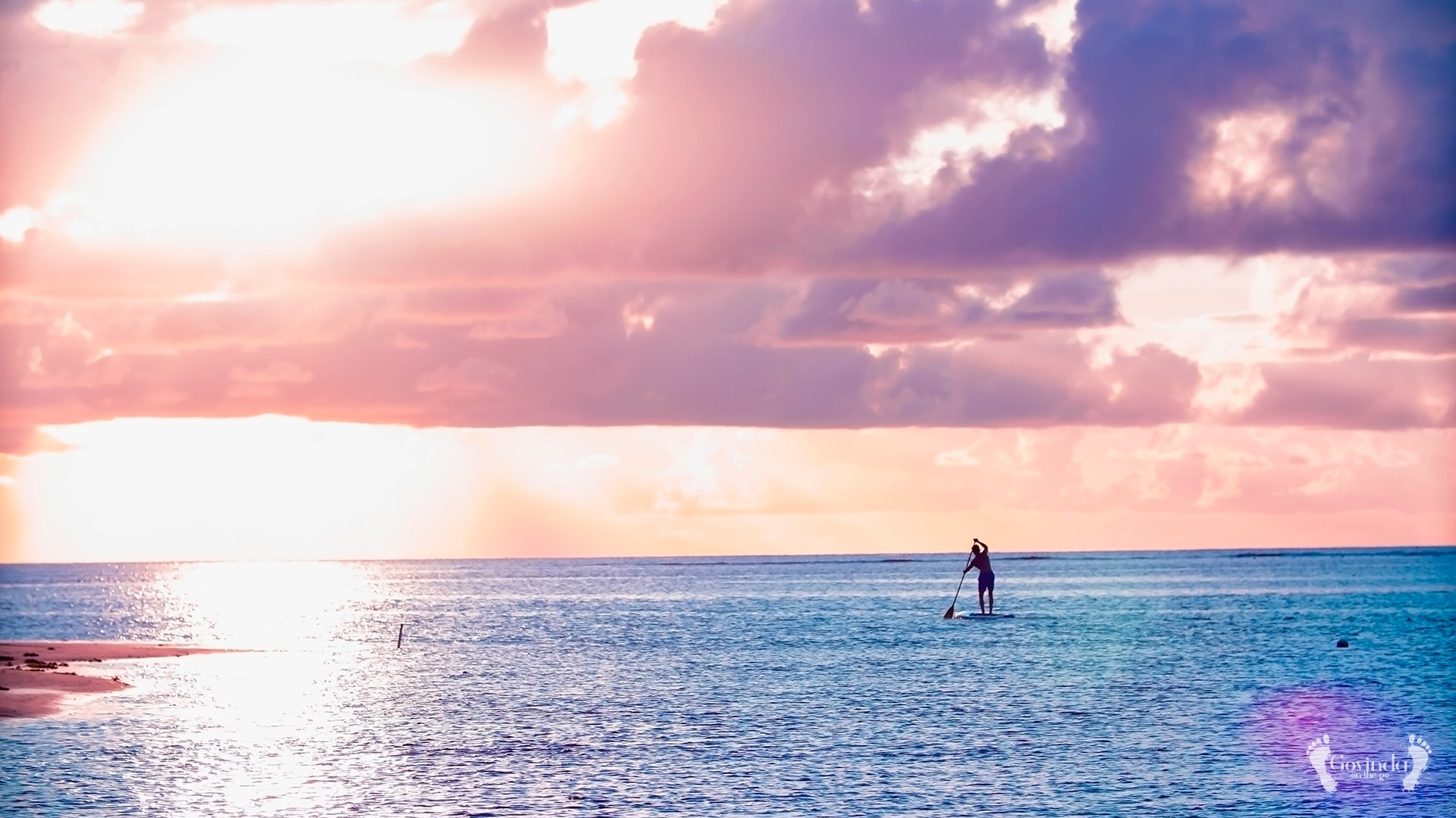 Surfing during sunset in Mauritius