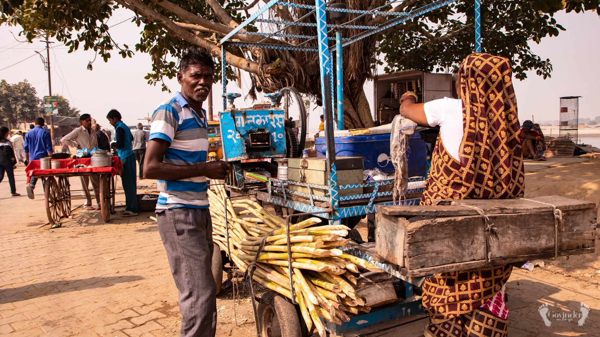 Making sugarcane juice on the bank of Yamuna