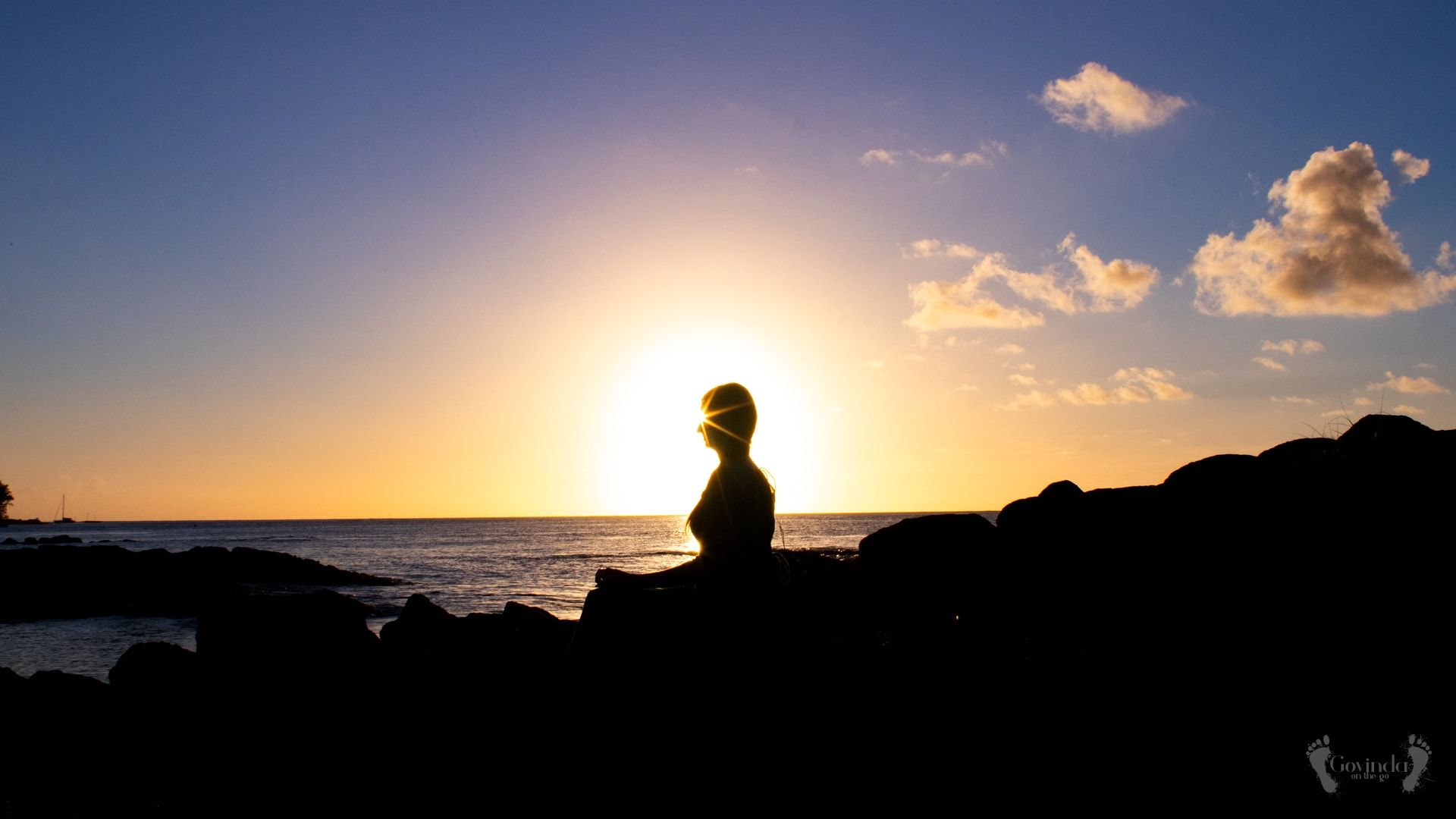 Woman meditating during sunset in Mauritius